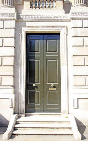 Steps leading to wooden door way Stock Photo