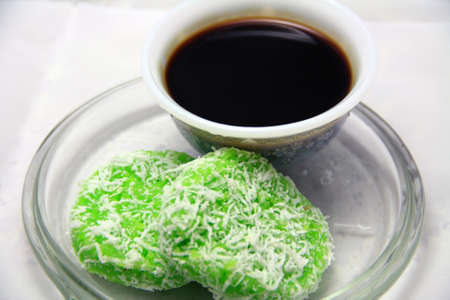 Traditional Malay food - Kuih Lopes served with Palm Sugar