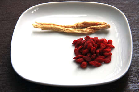 codonopsis roots: Chinese herb - Codonopsis pilosula, Goji berry, Wolfberry on a plate