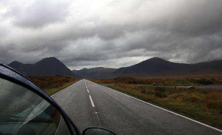 Driving through Scotland in cloudy weather