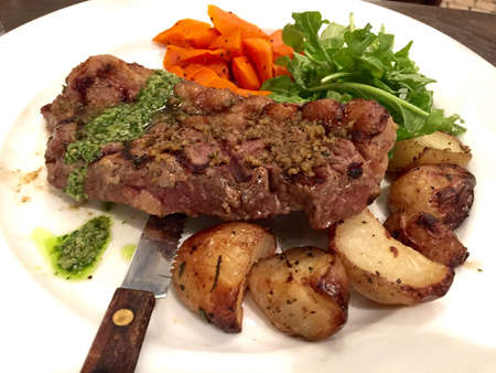 Crusted strip loin with parsley pesto