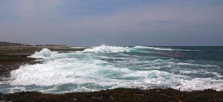 Crashing Waves on Shore Stock Photo