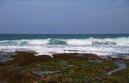 Waves crashing onto the shore Stock Photo