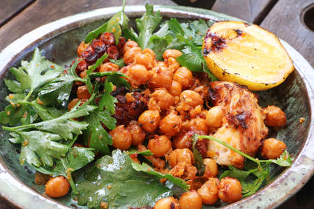 Barbequed Octopus Entree with crispy chickpea, parsley and grilled lemon