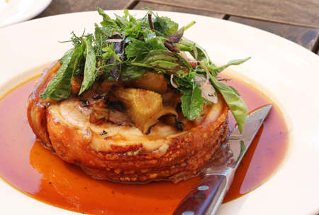 Trussed pork belly, with braised basil, shallots, fennel served in deicious gravy