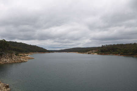catchment: Dark clouds gather at Mundaring Weir - dam in Perth Australia Stock Photo