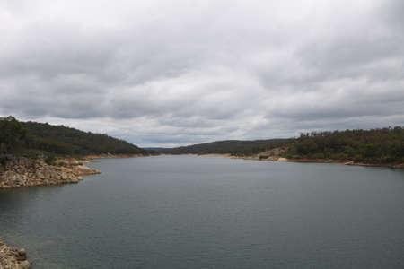 helena: Dark clouds gather at Mundaring Weir - dam in Perth Australia Stock Photo