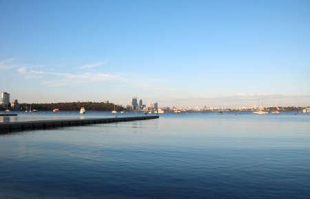 Perth city skyline at the horizon of Matilda Bay Reserve, Perth, Australia