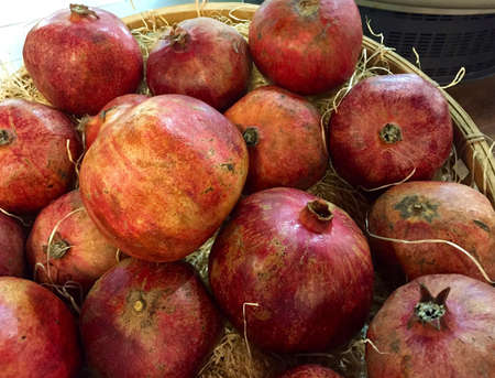 Basket of large ripe pomegranates