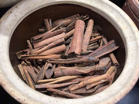 Cinnamon sticks in an earthenware Stock Photo