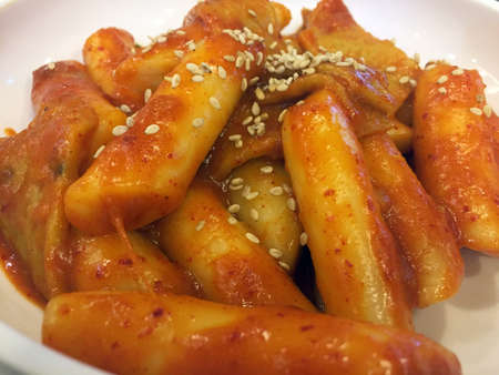 Korean rice cake with sesame garnish - close up Stock Photo