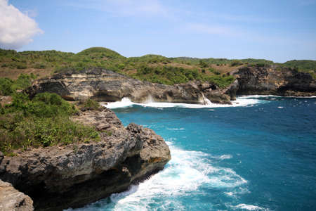 Clifts, Sea, Waves and Surf at Pasih Uug - Broken Beach, Nusa Penida, Bali, Indonesia