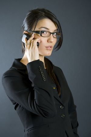 attractive businesswoman with mobile phone Stock Photo - 4141552