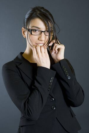 worried attractive businesswoman with mobile phone photo