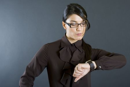 attractive business woman checking time photo