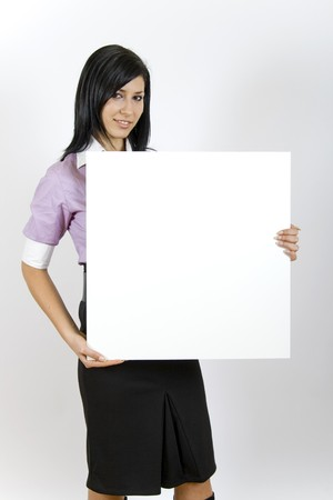 attractive business woman holding a blank board photo