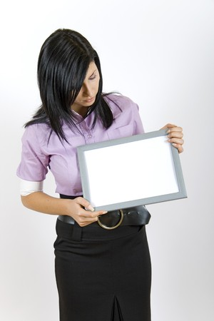 attractive business woman looking a blank frame photo