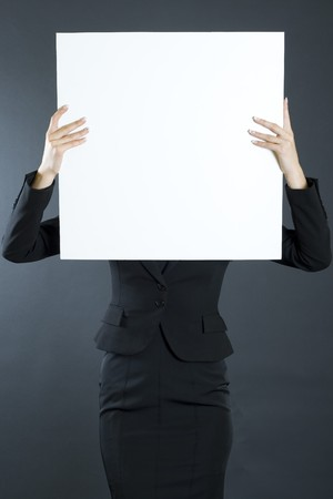 attractive businesswoman holding a blank board photo