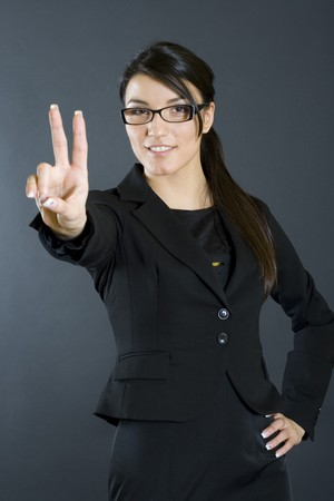 attractive businesswoman victory sign photo