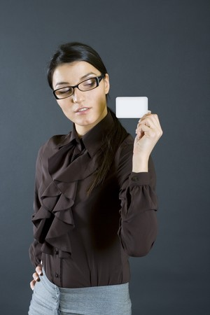 attractive business woman holding a card photo