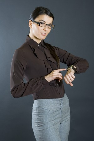 attractive businesswoman checking time photo