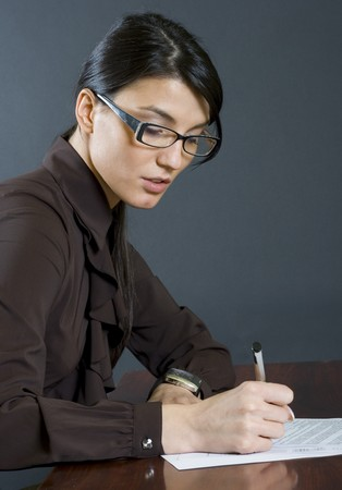 attractive business woman writing Stock Photo - 4191451