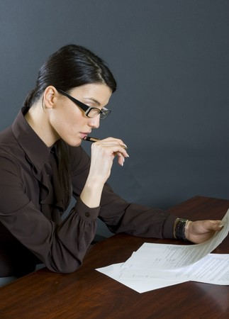 attractive businesswoman reading Stock Photo - 4191447