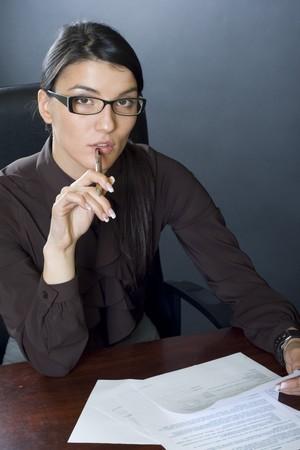 attractive businesswoman reading Stock Photo - 4191454