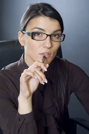 attractive businesswoman with pen Stock Photo - 4191478