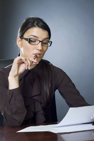 attractive businesswoman reading Stock Photo - 4191480