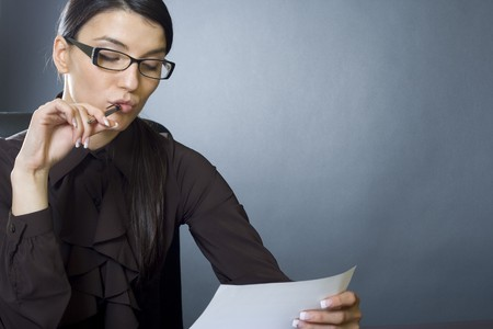 attractive businesswoman reading photo
