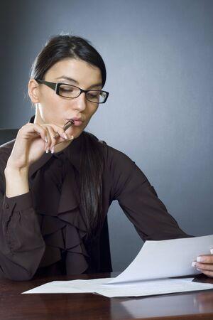 attractive businesswoman reading Stock Photo - 4191458