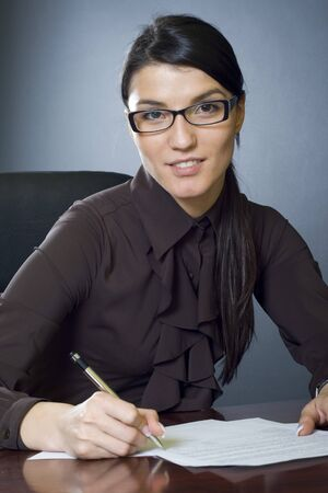 attractive businesswoman writing Stock Photo - 4191509