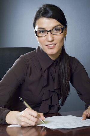 attractive businesswoman writing Stock Photo - 4191509
