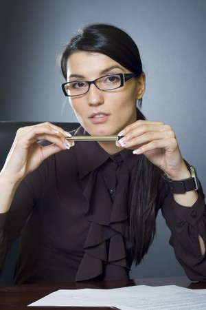 attractive businesswoman with pen Stock Photo - 4191452