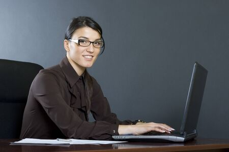 attractive businesswoman working on laptop photo