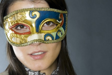attractive woman wearing a venetian carvival mask Stock Photo - 4201213