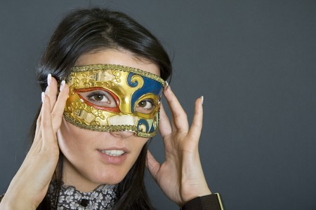 attractive woman wearing a venetian carvival mask Stock Photo - 4201215