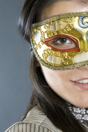 closeup of an attractive woman wearing a venetian carvival mask Stock Photo - 4201217