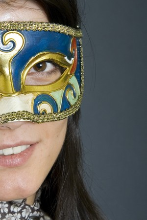 closeup of an attractive woman wearing a venetian carvival mask Stock Photo - 4201212