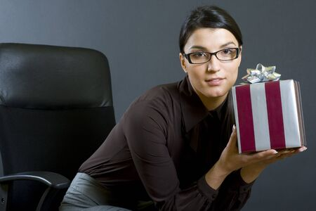 attractive business woman offering a gift photo