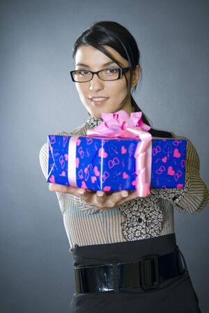 business woman offering a present photo