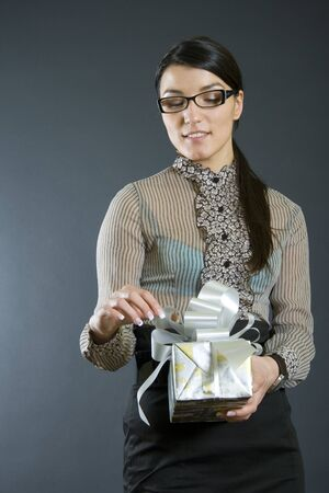 business woman holding a present photo