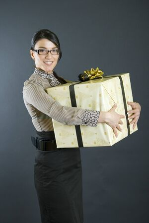 business woman holding a big present photo