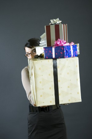 business woman holding a pile of presents photo