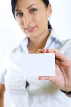 attractive businesswoman holding a blank card photo