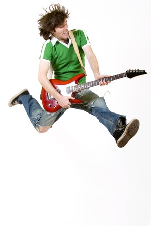 passionate guitarist jumps in the air photo