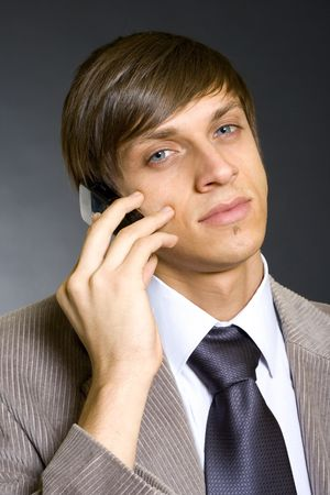 officetower: Young businessman calling on mobile phone Stock Photo