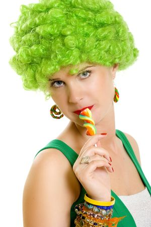 closeup of an attractive woman with green wig sucking on a lolly pop Stock Photo - 4942494