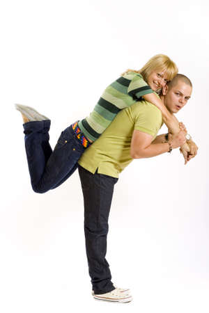 young man holding his girlfriend in the air Stock Photo - 4942534